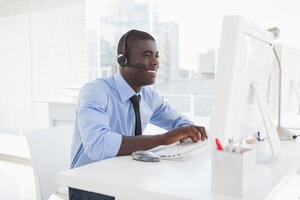 Telecommute-Happy-businessman-working-at-h-68941201