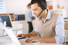 Telecommute-Portrait-of-consultant-on-the--47168845