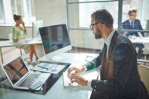 Salesperson monitors screens